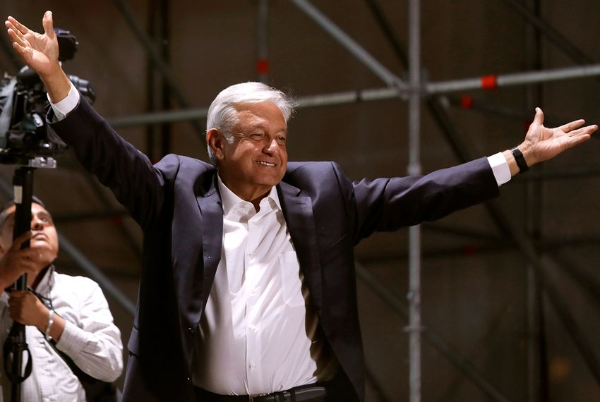 Newly elected Mexican President Andrés Manuel López Obrador gestures to supporters in Mexico City on July 1, 2018.