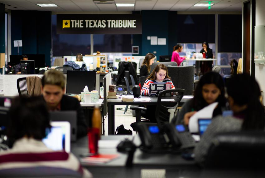 Fellows in the foreground work at The Texas Tribune office on Jan. 22, 2020.