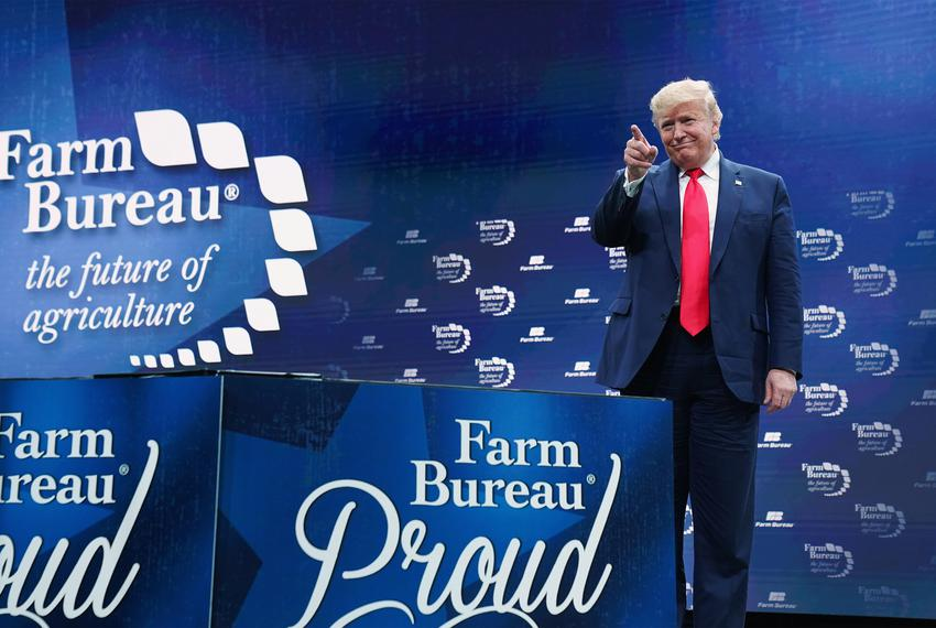 President Donald Trump gestures to the audience at the American Farm Bureau Federation's Annual Convention and Trade Show ...
