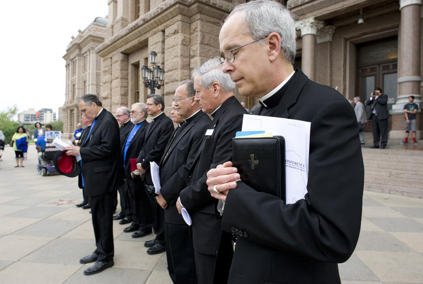 Texas Catholic bishops along with Cardinal Daniel DiNardo of Houston, l, pray on the South Steps of the Capitol on April 9, …
