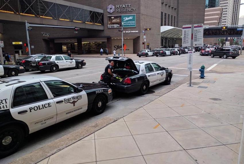 Fort Worth police cars took over a downtown Houston street Thursday, Aug. 31, 2017.