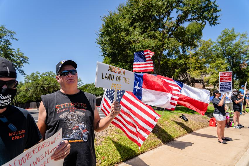 Bar owners and advocates gathered outside TABC headquarters in northwest Austin to protest the continued closure of bars o...