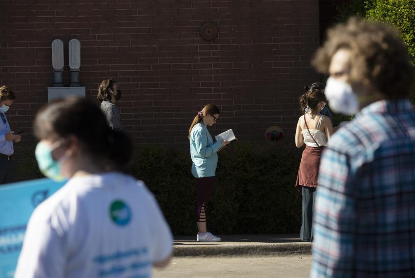 Voters stand in line at the Oak Lawn Branch Library to cast their ballots on Election Day in Dallas. Nov. 3, 2020.