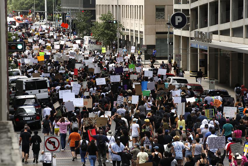 Protesters gathered at a rally for George Floyd in Houston. Floyd, a former Houston resident, was killed by a white police o…