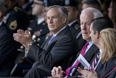Gov. Greg Abbott applauds the Purple Heart recipients during the ceremony at Fort Hood.