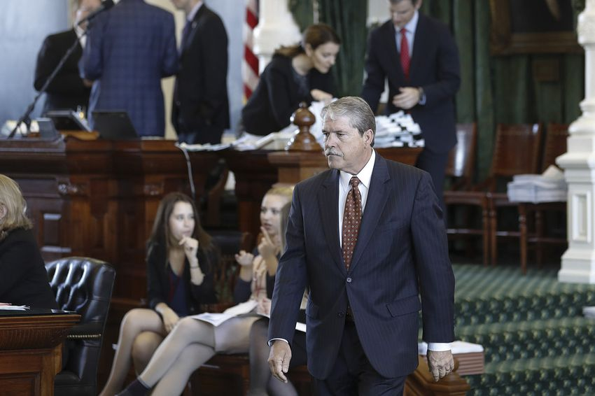 State Sen. Larry Taylor walks across the Senate floor on May 24, 2017.