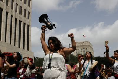 Sandra Luz Gonzalez and fellow demonstrators march through the streets of downtown Houston.