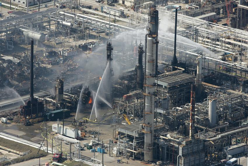 Firefighters pour water on a smoldering unit following an explosion that rocked the BP refinery Wednesday, March 23, 2005, i…
