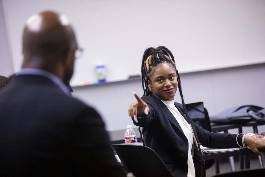 LaMontria Edwards points at Paul Quinn College President Michael Sorrell during his weekly class on problem solving on Nov. …