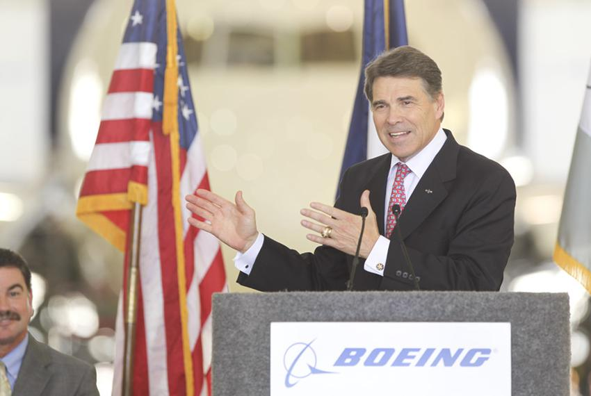 Texas Governor Rick Perry talks about the Texas economy while speaking in front of a Boeing 787 airplane during the ceremoni…