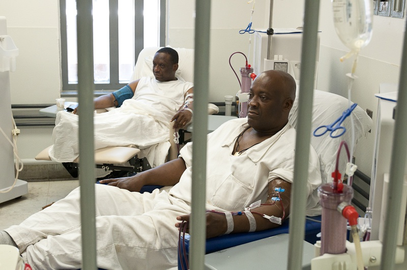 Inmates Roberto Bisco and Robbie Robinson undergo dialysis in the medical center of the Estelle Unit in Huntsville, Texas.