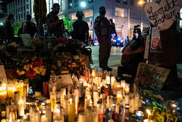 Armed protesters guard the memorial of Garrett Foster, who was shot and killed during a protest against police brutality in Austin on July 25, 2020.