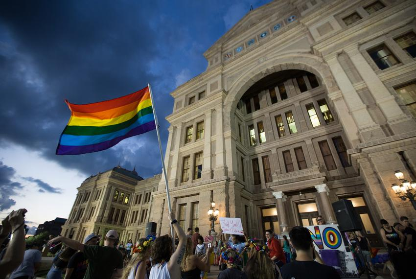 Members of Austin's LGBT community gather on the steps of the capitol to celebrate the anniversary of the 1969 Stonewall rio…