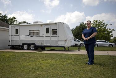 Marissa Hudler and her husband, both health care workers, pulled an RV used for family camping trips out of storage and plan to use it to isolate if one of them is exposed to the virus.