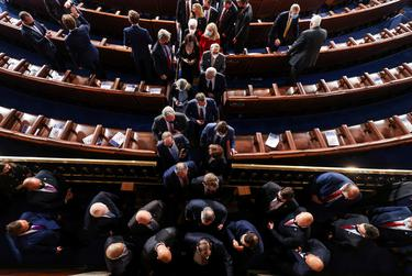 Members of the House depart after the first session of the 117th Congress in the House Chamber at the U.S. Capitol in Washington, DC, Jan. 3, 2021.