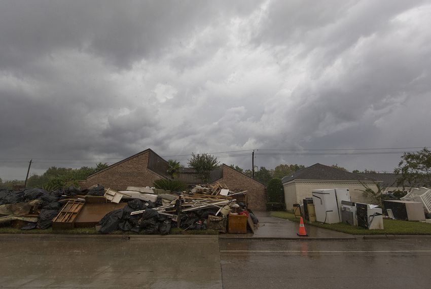 Water-damaged debris from Houston homes and businesses near the Barker Dam and Reservoir piled up on the curbside weeks after Hurricane Harvey flooded the city.