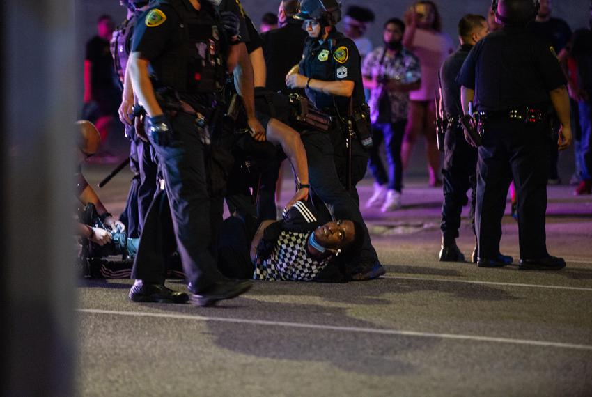 Protesters march through downtown Houston demanding accountability and justice for African American lives lost to police vio…