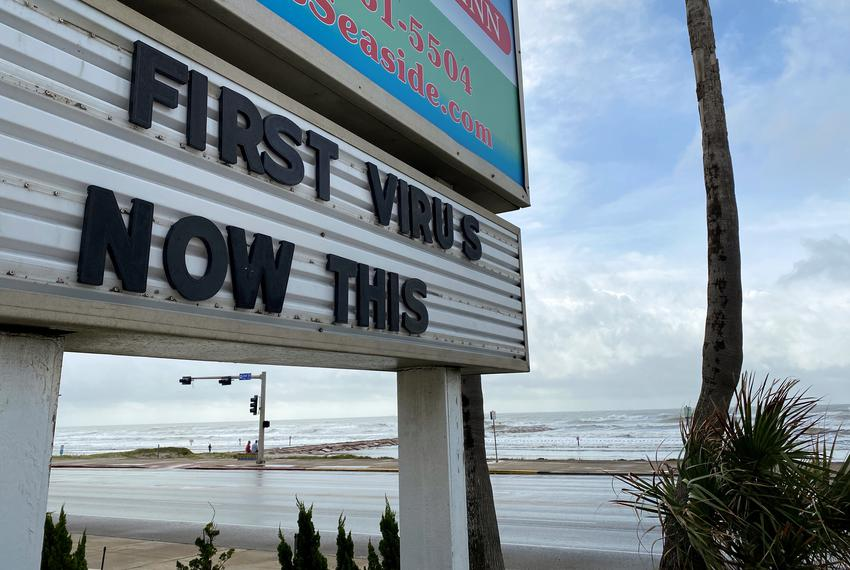 A sign referencing COVID-19 and Hurricane Laura in Galveston on Aug. 26, 2020.