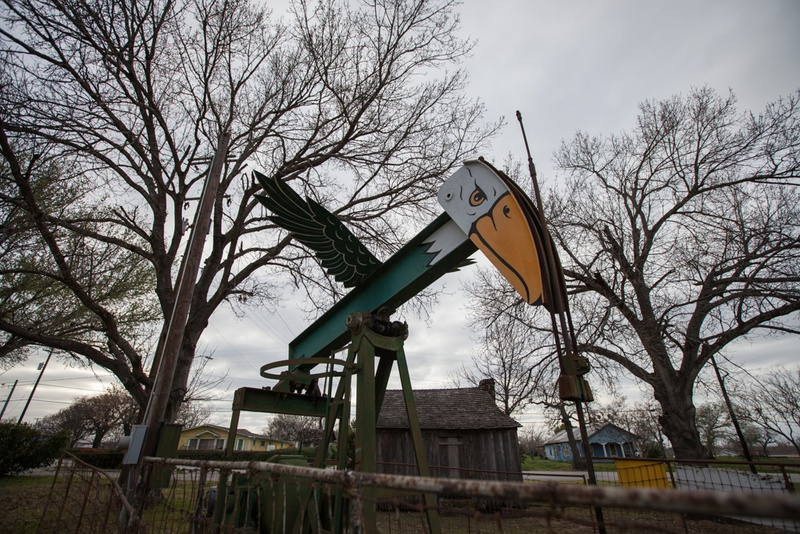 In Blanche Square of off U.S. 183, an eagle bobs up and down with the pump jack.
