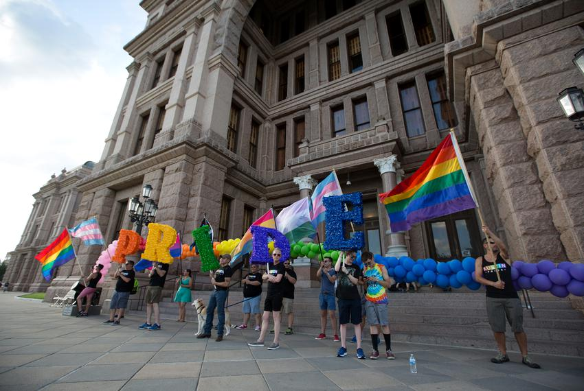 Activists and members of Austin's LGBTQ community gather on the steps of the capitol to celebrate the anniversary of the 196…