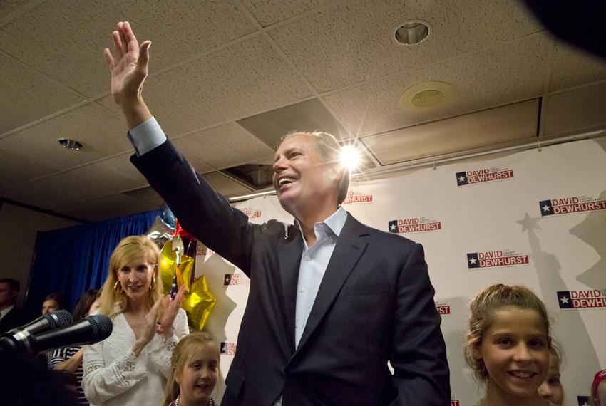 Lt. Gov. David Dewhurst waves after speaking to a crowd on primary election night in Houston.