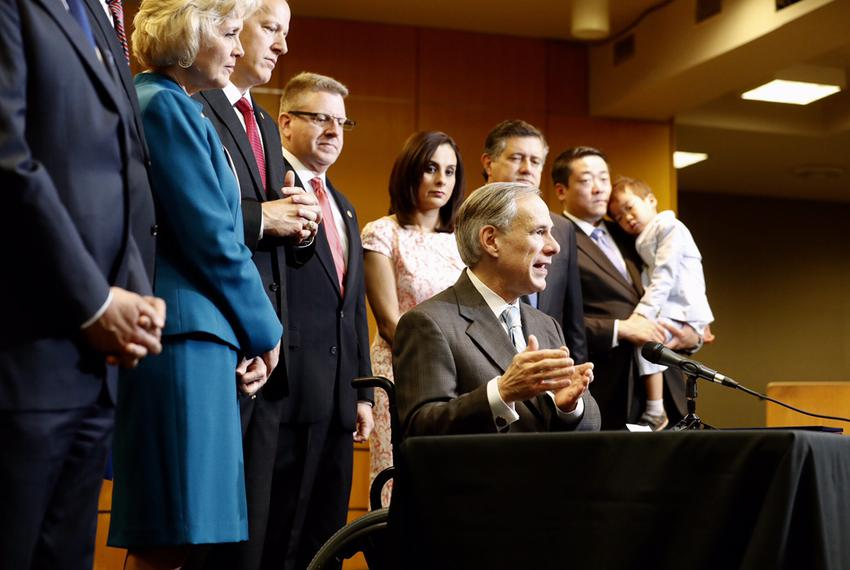 Gov. Greg Abbott signs four bills aimed at reforming Child Protective Services, at the Texas Department of Family and Prot...