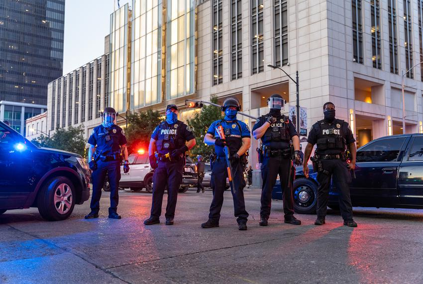 Protesters clash with police in riot gear in downtown Austin on August 1, 2020.