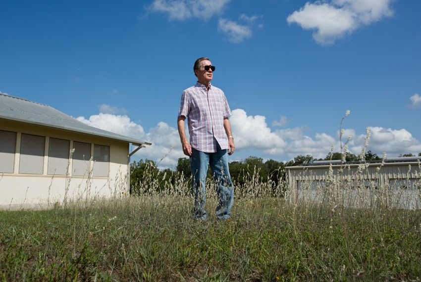 Darwyn Hanna grows pecans and runs cattle on some of the land he owns in Bastrop County. He is contesting a water marketer's bid to pump about 15 billion gallons a year from the Carrizo-Wilcox Aquifer in Bastrop County, saying the plan would devalue his property.