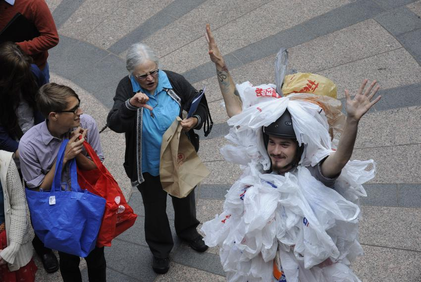 "An environmentalist dressed as a ""bag monster"" protests HB 2416 on March 20, 2013 by State Rep. Drew Springer, R-Muenster, b…"