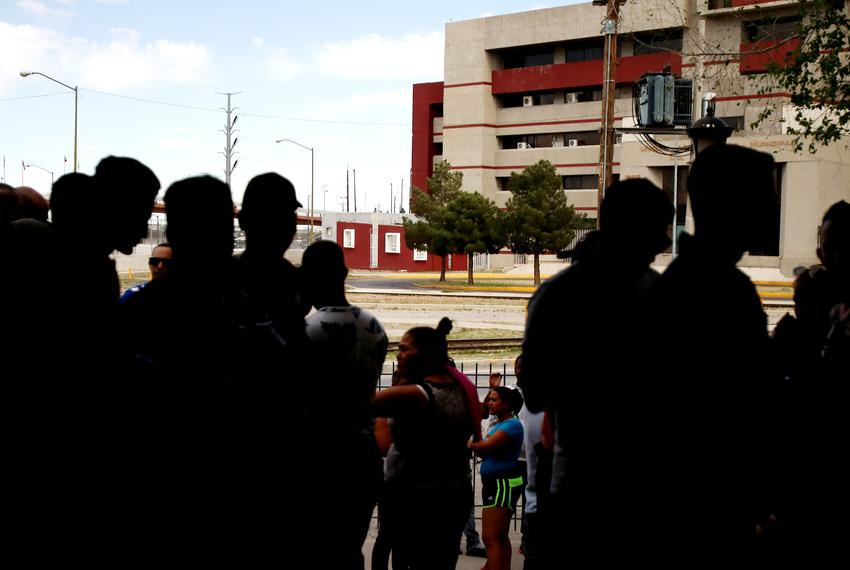 Dozens of migrants wait outside Ciudad Juárez's Centro de Atención a Migrantes waiting to see if they'll be able to enter ...