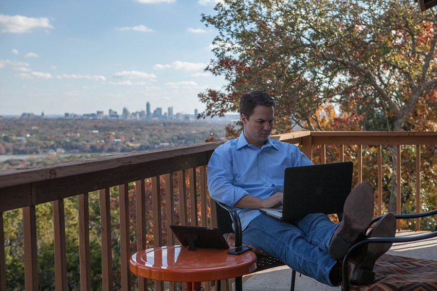 W. Corbin Casteel, President of Four One Three Communications and political consultant, works from his home office in west Austin on December 18, 2013.