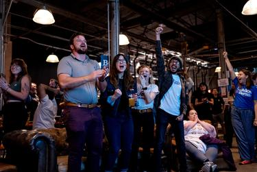 At a Bernie Sanders Super Tuesday Watch Party in Austin, TX, Sarah Stuchberry, James Lamarche, and Julia Mason cheer as Bernie Sanders takes a 6 point lead in Texas.