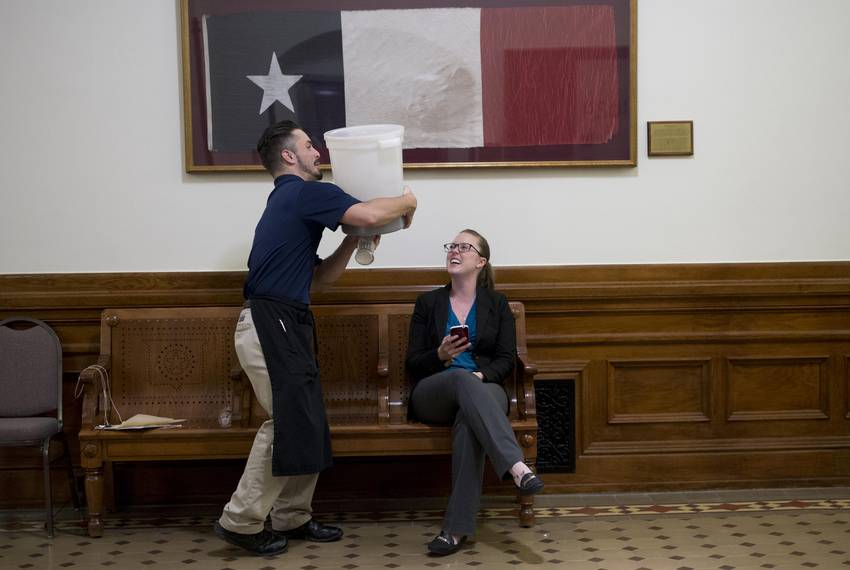 9:20 p.m. — House sergeant-at-arms Kimberly Nemecek watches a House staffer clean up in the back hall after state Rep. Cha...