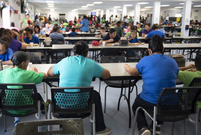 Dilley, TX August 23, 2019: Mothers and children eat lunch in the cafeteria located at U.S. Immigration and Customs Enforc...