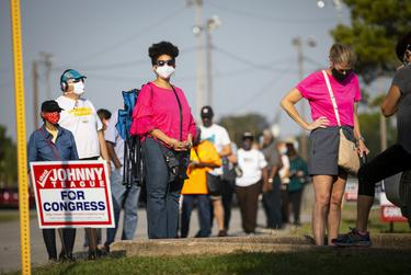 Harris County residents waiting in line at the Bayland Community Center during the first day of early voting in Houston on Oct. 13, 2020.