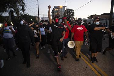 Protesters march in Dallas in memory of George Floyd and Breonna Taylor on May 29, 2019.
