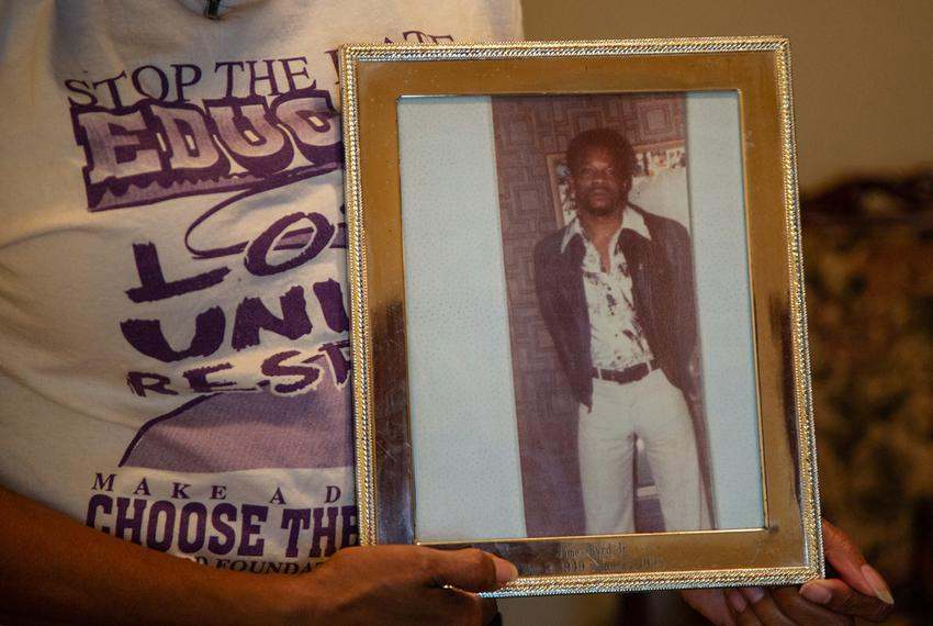 Louvon Harris holds a photo of her brother, James Byrd Jr., at her home in Cypress, Texas. James was murdered in 1998 by thr…