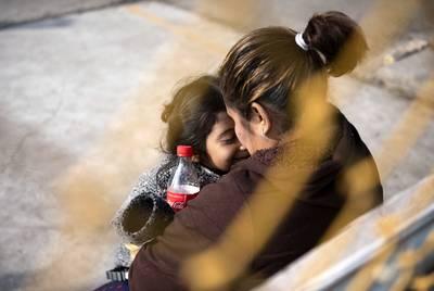 Iris Portillo and her daughter, Daniela Portillo, share a hug inside the migrant shelter in Piedras Negras on Feb. 18, 2019.