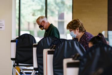 Voters cast their ballots at the Performing Arts Center at Texas State University in San Marcos.
