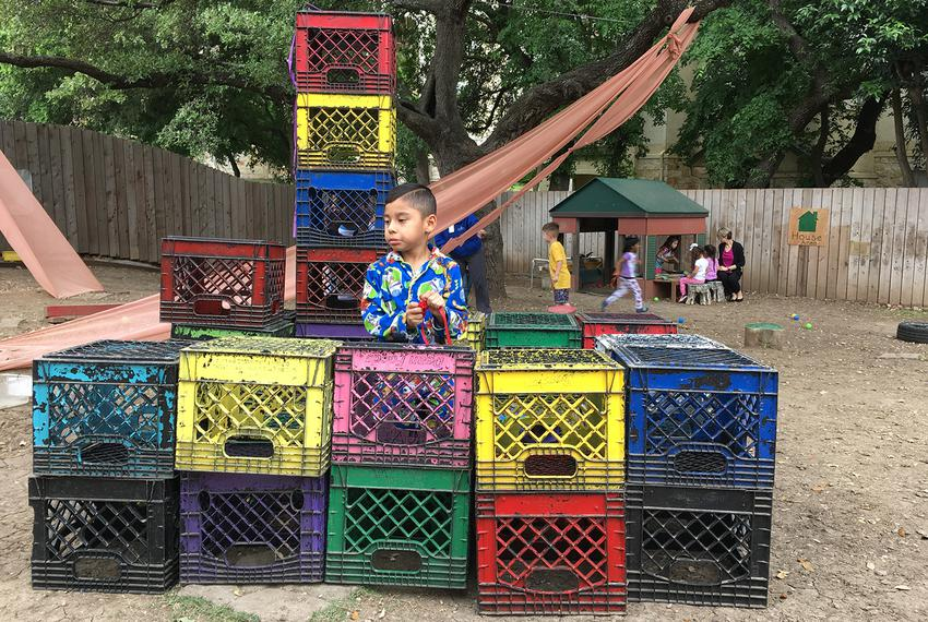 Students engage in creative activities on the playground at Pre-K 4 SA North Education Center in San Antonio, Texas.