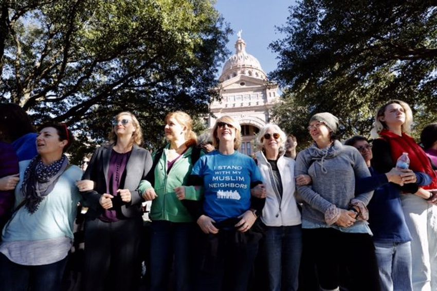 Supporters create a human shield for participants attending Texas Muslim Capitol Day on Jan. 31, 2017.