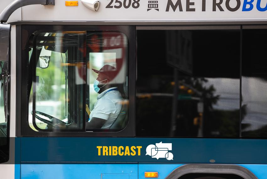 A CapMetro bus driver wears a mask while driving his route in Austin on May 16, 2020.