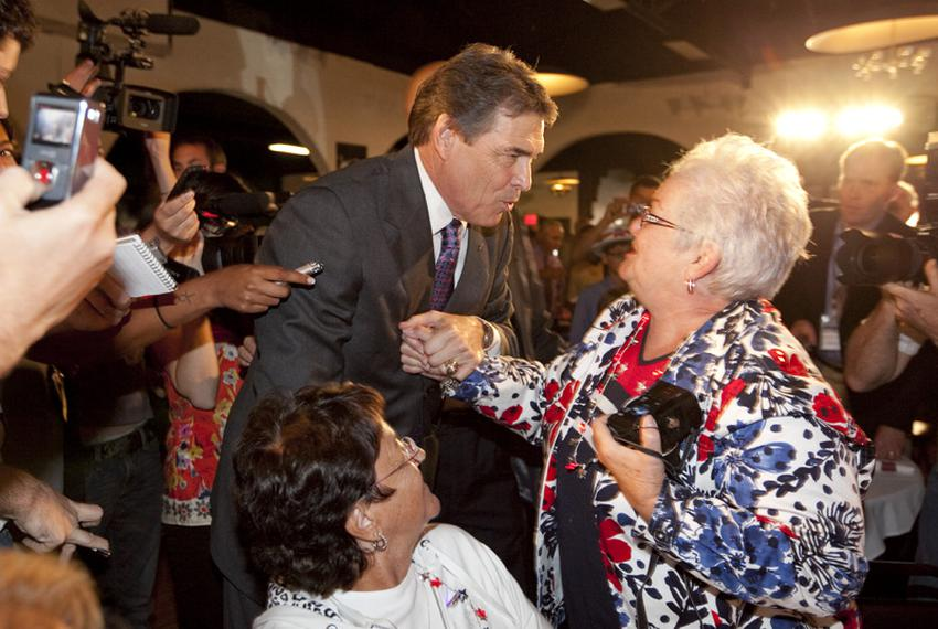 Governor Rick Perry greets Republican Linda Love at the Electric Park Ballroom on August 14th on his arrival in Iowa for thr…