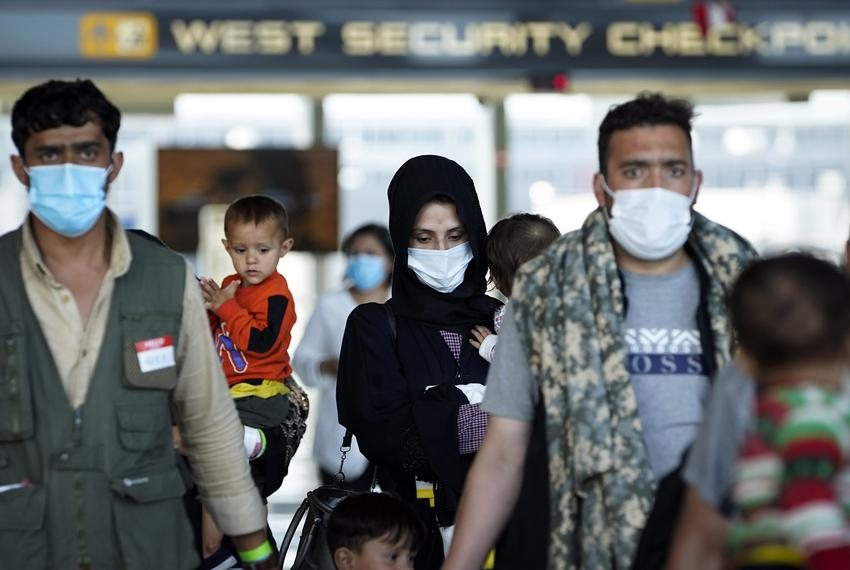 Afghan refugees arrive at Dulles International Airport in Northern Virginia while en route to military facilities in the U.S…