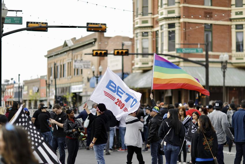 Presidential candidate Beto O'Rourke's supporters, including one holding a LGBTQ Pride flag, gather ahead of a rally in El Paso in March.