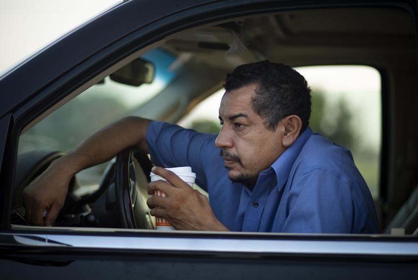 Juan Lopez drinks a coffee during a break from his busy morning of picking up dead bodies and delivering them to funeral h...