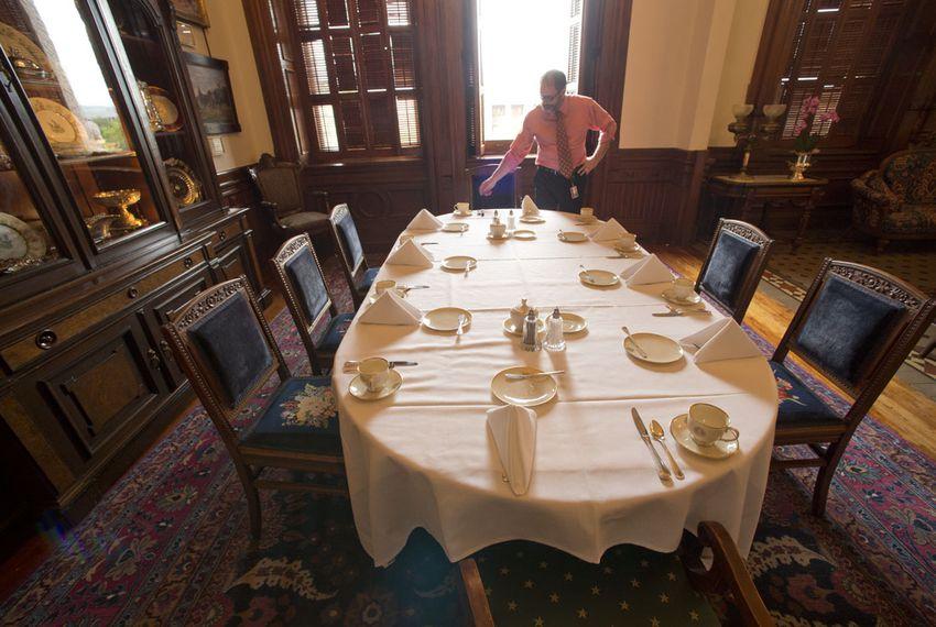 Timothy Mateer straightens napkins at the table in the Lt. Governor's Reception Room where Lt. Gov. Dan Patrick, House Speaker Joe Straus and Gov. Greg Abbott will meet April 29, 2015 for their weekly leadership breakfast.