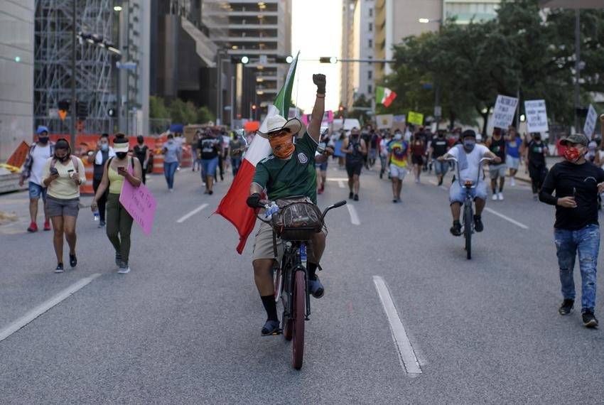 Hundreds of protesters marched through downtown Houston during a protest over the death of Vanessa Guillen. Guillen was a Ho…