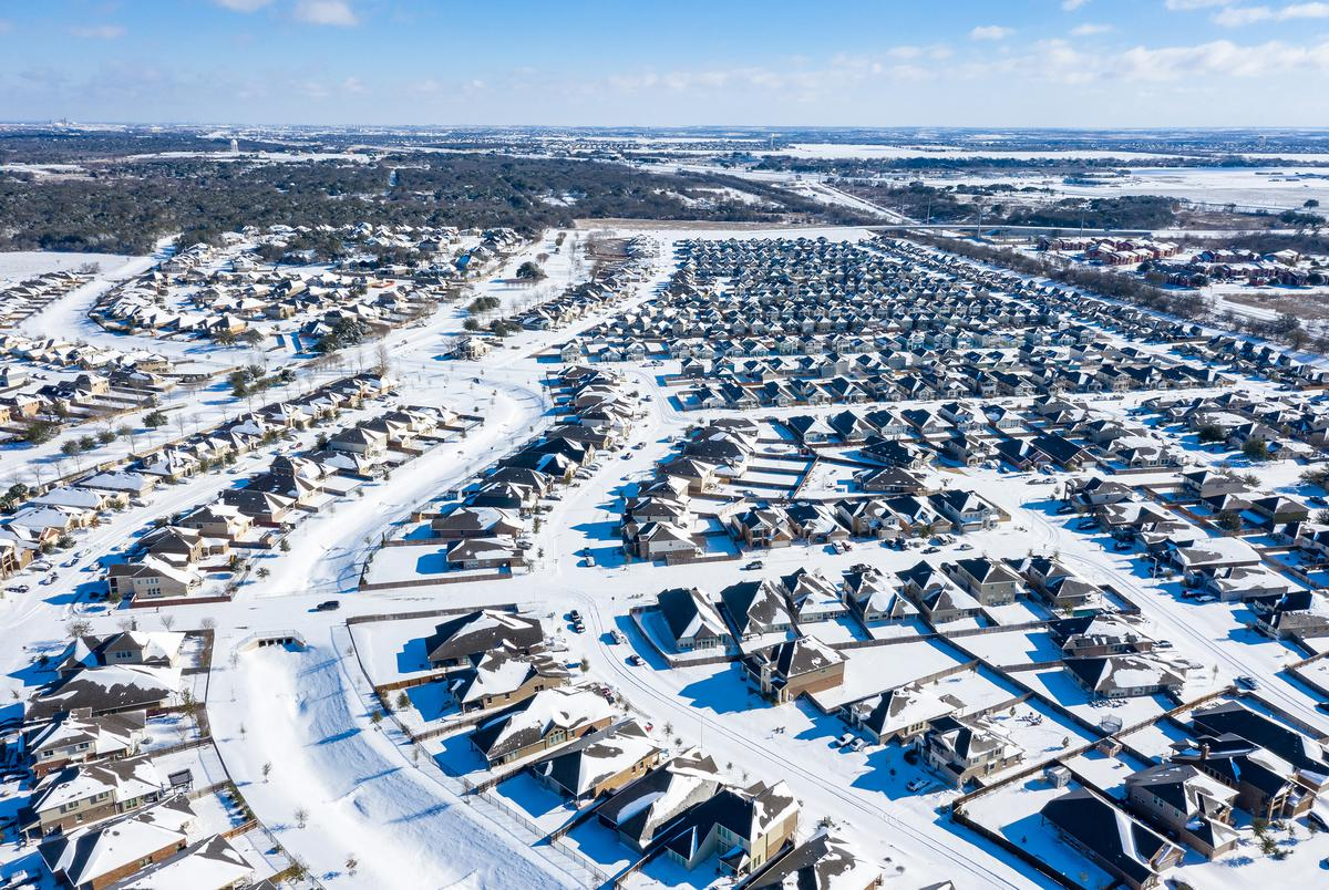 The Blanco Vista neighborhood of San Marcos is blanketed with several inches of snow as a massive winter weather system causes power outages across Texas on Feb. 15, 2021.