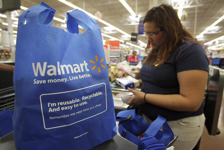 An employee at a Walmart in Brownsville works the cash register.